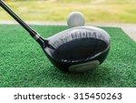 Close Up Of A Golf Ball And A...