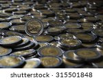 One Peso Coin On A Group Of...