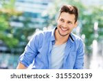 young man smiling  | Shutterstock . vector #315520139