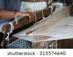 Close Up Of Gold Silk Weaving...
