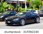MENTON, FRANCE - AUGUST 2, 2014: Motor car Aston Martin Vantage at the city street. - stock photo