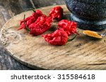 Small photo of very strongly hot pepper Carolina Reaper or HP22B