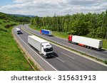 trucks traveling on an asphalt... | Shutterstock . vector #315631913