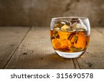 single glass of whisky bourbon... | Shutterstock . vector #315690578