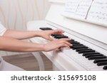 hands on the white keys of the... | Shutterstock . vector #315695108