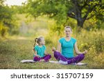 mom and child in the lotus... | Shutterstock . vector #315707159