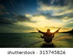 Small photo of Relaxing businessman sitting on beach, Success in business concept
