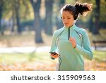 young woman with headphones... | Shutterstock . vector #315909563