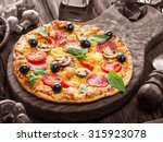 pizza with mushrooms  salami... | Shutterstock . vector #315923078
