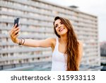 Young Happy Woman Taking Selfi...