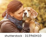 woman and her favorite dog... | Shutterstock . vector #315960410