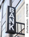 bank sign in urban setting | Shutterstock . vector #315965558