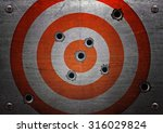 target with bullet holes | Shutterstock . vector #316029824