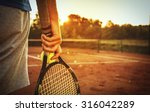 close up of man holding tennis... | Shutterstock . vector #316042289