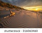 sand dunes against the sunset... | Shutterstock . vector #316063460