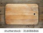 chopping board on wooden... | Shutterstock . vector #316086866