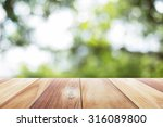 close up wooden table with... | Shutterstock . vector #316089800