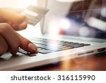 close up of hands using laptop... | Shutterstock . vector #316115990