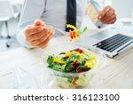 Businessman Having A Lunch...