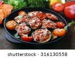 baked and fresh vegetables on... | Shutterstock . vector #316130558