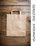 kraft paper bag with handles on ... | Shutterstock . vector #316155650