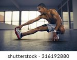 sports. man at the gym doing... | Shutterstock . vector #316192880