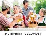 friends in bavarian beer garden ... | Shutterstock . vector #316204064
