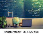 laptop and globe on table of...   Shutterstock . vector #316229558