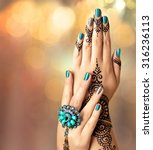 Woman Hands With Black Mehndi...