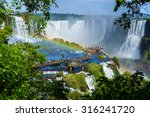 Stock photo tourists at iguazu falls one of the world s great natural wonders on the border of brazil and 316241720