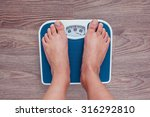 girl is measuring her weight on ... | Shutterstock . vector #316292810