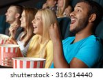 friends laughing during a movie ... | Shutterstock . vector #316314440