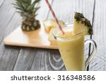 pineapple smoothie on wood... | Shutterstock . vector #316348586