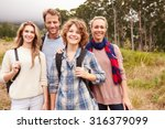 happy family outdoor portrait... | Shutterstock . vector #316379099