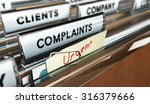 Stock photo close up on a file tab with the word complaints focus on the main text and blur effect concept 316379666