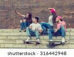 skateboarder friends on the... | Shutterstock . vector #316442948