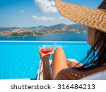 woman relaxing by the infinity... | Shutterstock . vector #316484213