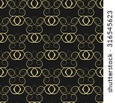 gold pattern from curls on a... | Shutterstock . vector #316545623