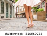 woman with beautiful legs... | Shutterstock . vector #316560233