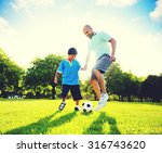 father son playing soccer park... | Shutterstock . vector #316743620