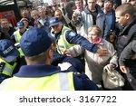police officers arrest people