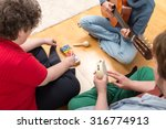 Small photo of three persons playing sundry instruments at home