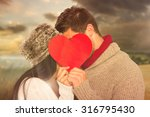 Young Couple Kissing Behind Red ...
