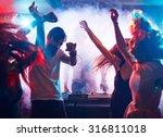 Young Energetic People Dancing...