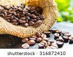 roasted coffee beans in burlap...   Shutterstock . vector #316872410