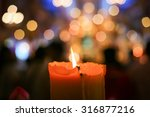 burning candle with bokeh blur... | Shutterstock . vector #316877216
