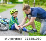 father putting band aid on... | Shutterstock . vector #316881080