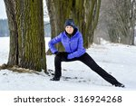 woman stretching at the park | Shutterstock . vector #316924268