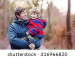 happy dad holding his son ... | Shutterstock . vector #316966820