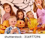 family on halloween party with... | Shutterstock . vector #316977296